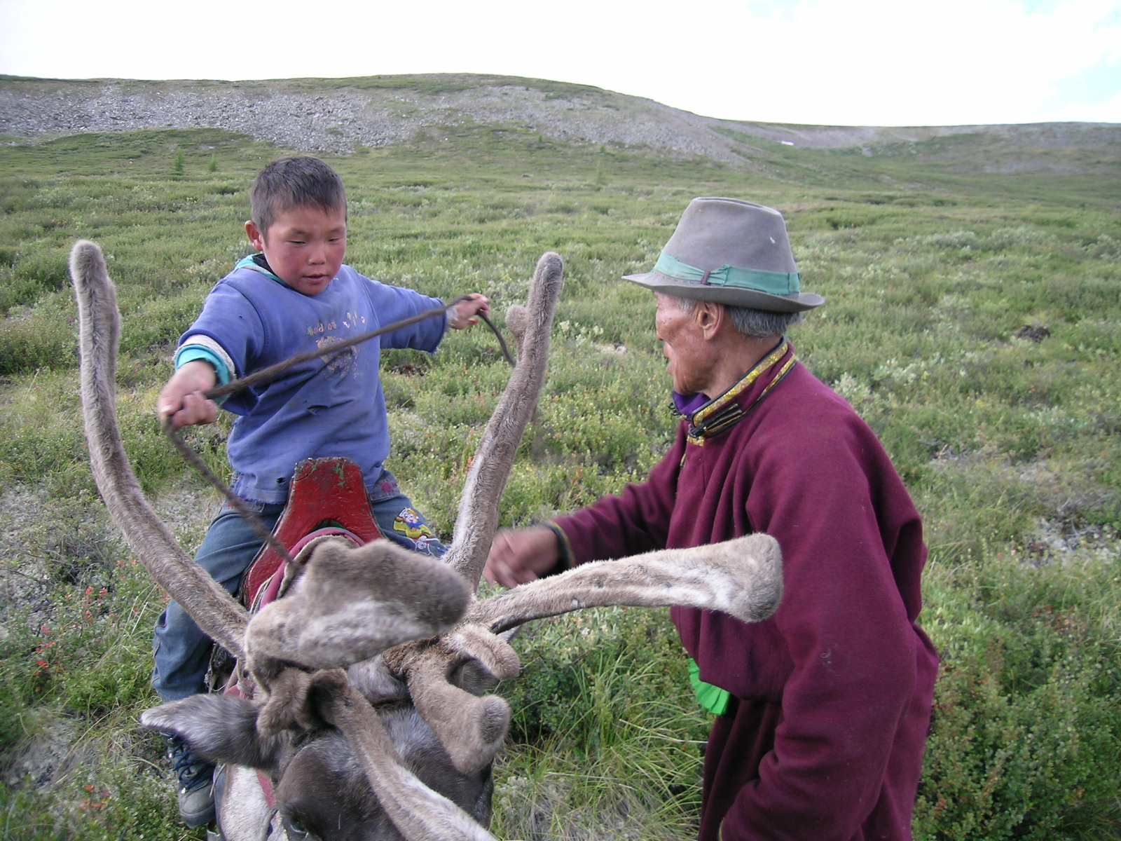 61-year-old Sanjim with his 12-year-old grandson, Mukhertinn. Of Sanjim's 13 children, only 3 have elected to remain nomadic reindeer herders.