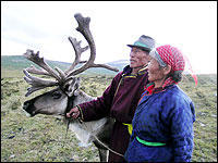 Lorne Matalon/Worlds of Difference Tsachin elder Sanjim and his wife at dusk on the taiga. They move every few weeks to find fresh grasses for their reindeer.