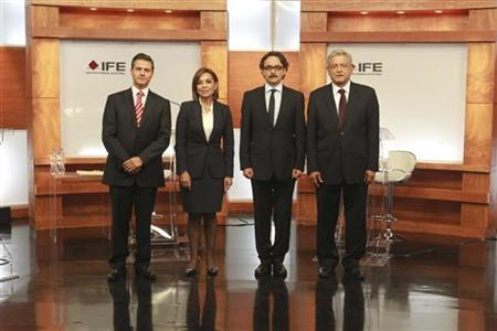 Handout of presidential candidates posing before attending their first televised debate in Mexico City's World Trade Centre