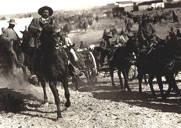Pancho Villa, born José Doroteo Arango Arámbula on his horse named Siete Laguas after the Battle of Ojinaga. This image captured a part of his legacy, that of an excellent rider who led his men into battle. Photography by Mutual Film Company