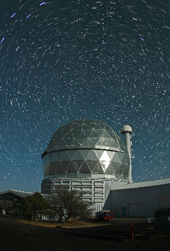 The Hobby-Eberly Telescope is surrounded by star trails centered on Polaris, the North Star (Frank Cianciolo, McDonald Observatory)