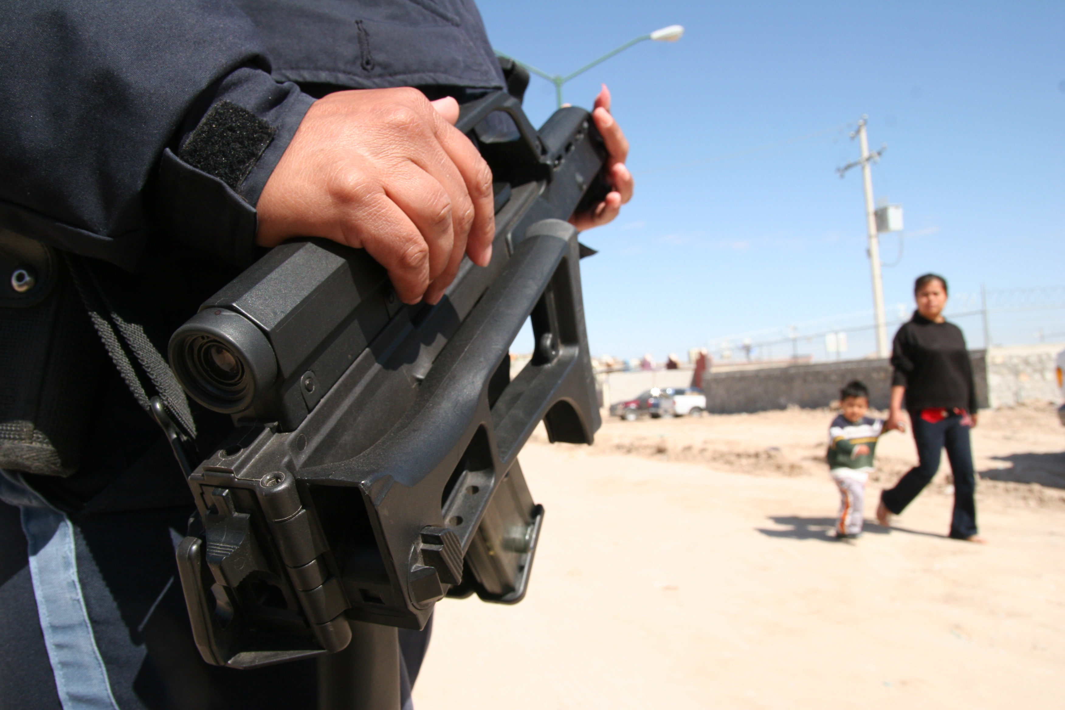 A Mexican Federal Police officer stands guard in a neighborhood on the outskirts of Juárez. Residents said some of their neighbors had left when the Sinaloa and Juárez cartels fought during some of the worst years of the violence. March 15, 2009 (Lorne Matalon)