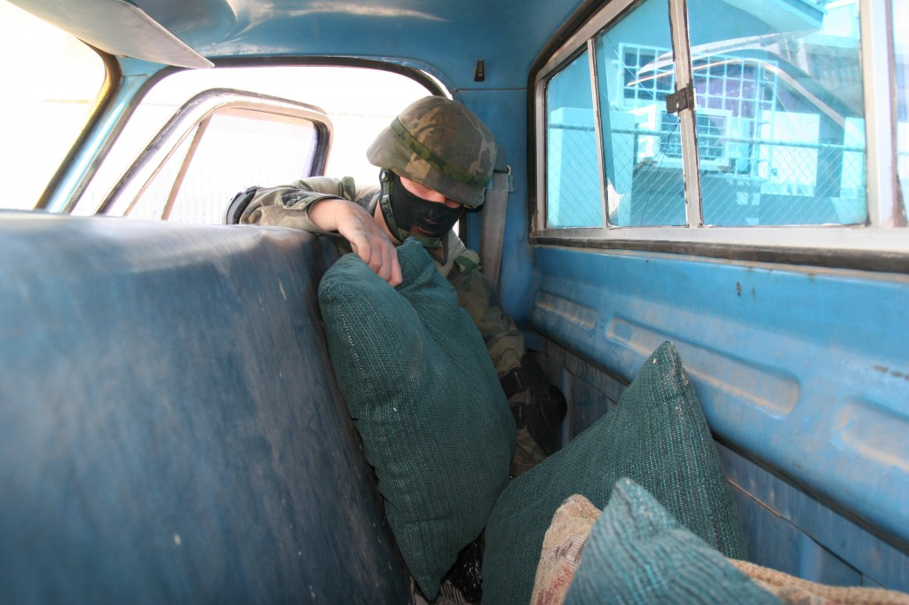 A Mexican soldier checks a car entering Juárez from El Paso, Texas. The military entered Juárez following allegations that local police had been compromised by either the Sinaloa or Juárez cartels. March 17, 2009 (Lorne Matalon)