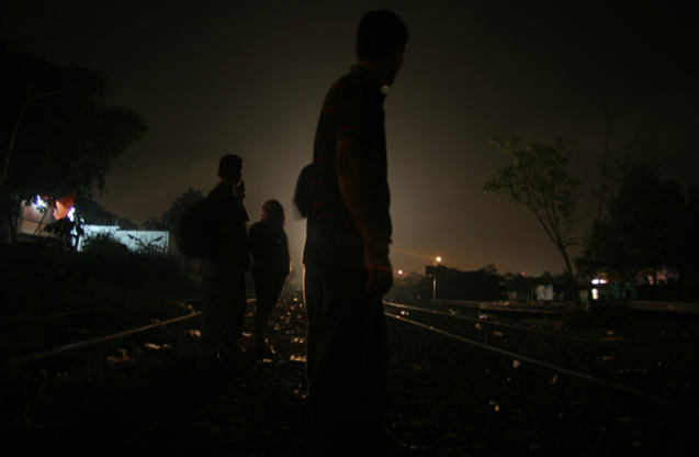 Shadows move across the tracks as La Bestia, a cargo train known as The Beast, approaches from the southern Mexican state of Chiapas into the state of Veracruz.(Lorne Matalon)
