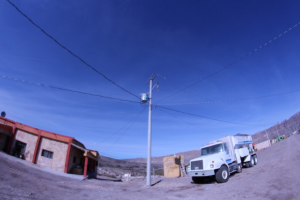 Wires distributing solar power flow from a utility pole, Boquillas, Coahuila (Lorne Matalon)
