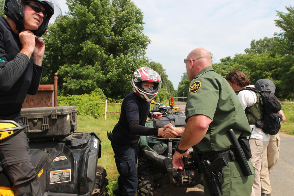A U.S. Border Patrol agent greets an officer from Canada's federal police, the RCMP, in Vermont steps inside the U.S. The two agencies cooperate closely on the northern border. Some analysts suggest the potential for terrorists to enter the U.S. is more pronounced on the Canada border than on the Mexico border. (Lorne Matalon)