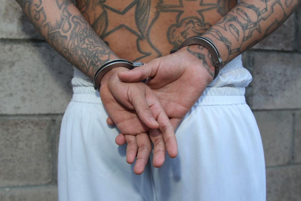 A member of Mara Salvatrucha's main rival, a group known as Calle 18, in prison near La Libertad, El Salvador. The man admitted he had been running weapons in the country. He claimed he needed the weapons to protect himself against attacks. (Lorne Matalon)