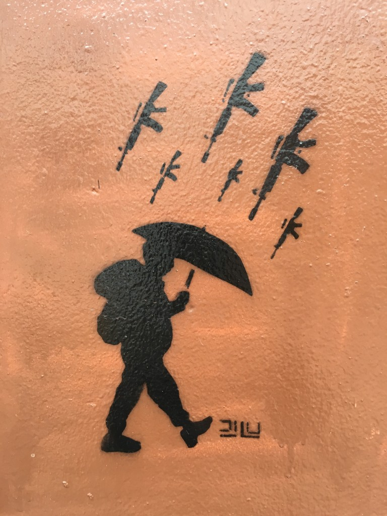 The image on a Bogotá home suggests violence has been raining down on Colombia for too long. (Lorne Matalon)